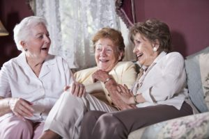 Elderly women on living room sofa